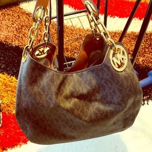Michael kors Hand bag, Dooney and Burke hand bag,